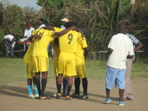 The teams usually pray in their huddle before they begin the match